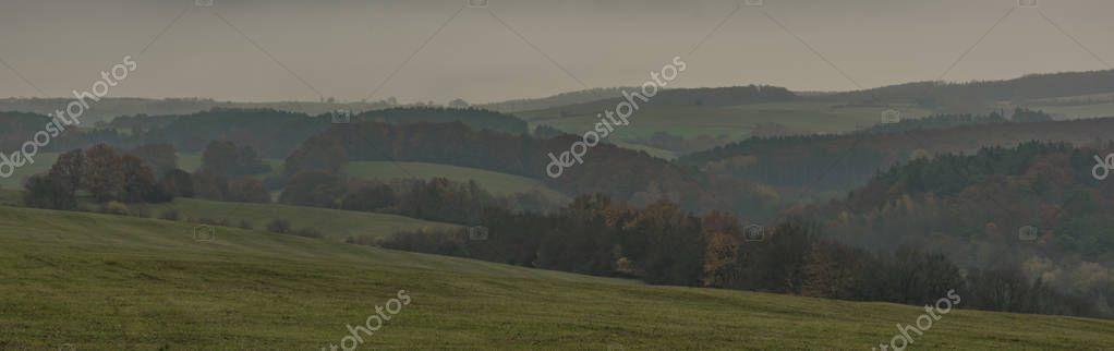Landscape near Bojkovice town in Moravia region in autumn dark fog day