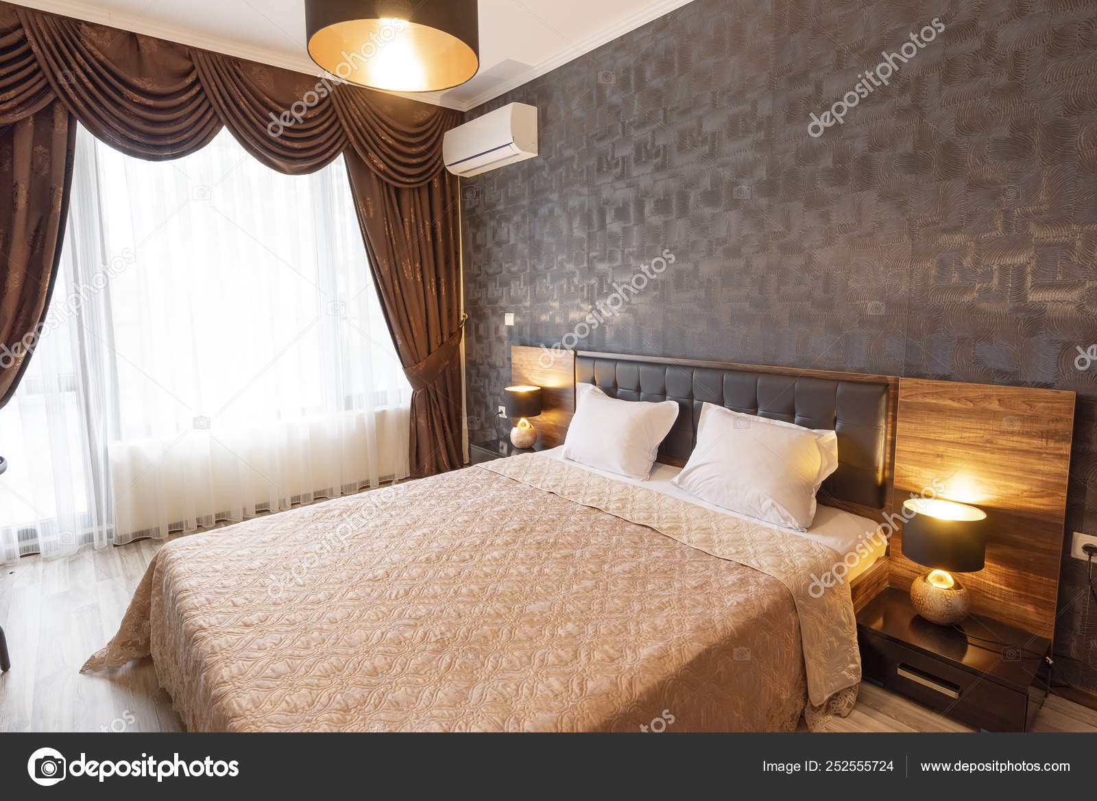 Classy Bedroom Interior Design Large Bed Room With Brown Color Tone Furniture Windows With Long Curtains Drapery And Sheers Interior Photography Stock Photo C Snj Abv Bg 252555724