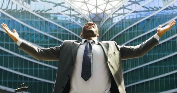 successful happy african business man at modern glass building, slow motion video