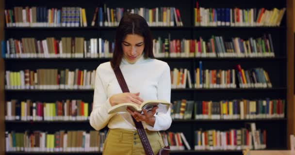 A  young student studying in a happy and carefree library reading the book. Concept: educational, portrait, library, and studious, relax.