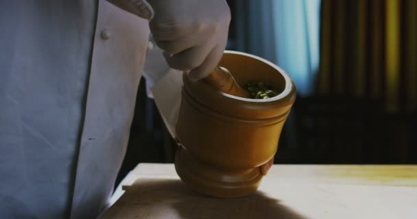 slow motion video of chef using Mortar and Pestle for spices