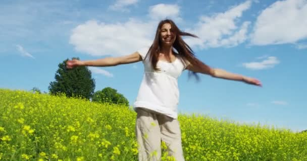 video of happy woman enjoying summer outdoor in nature and spinning around