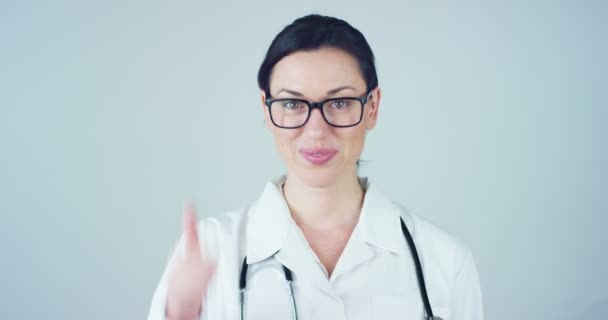 video of woman doctor with white coat and stethoscope and showing thumbs up