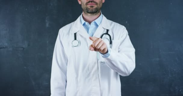 video of professional doctor man wearing white lab coat and stethoscope pointing finger on camera