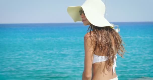 back view video of woman having vacation and enjoying sea view