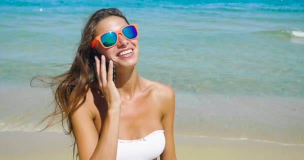 video of woman talking on mobile phone and wearing glasses
