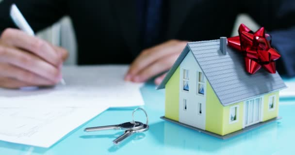 rent or purchase the house .the hands of an insurer or real estate agent showing a house with house keys .