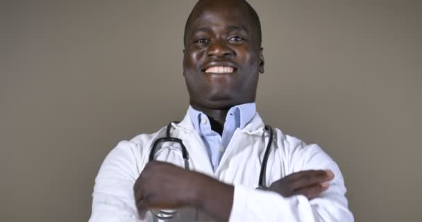 video of African-american doctor man in white lab coat posing on camera with arms crossed