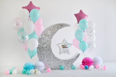 Beautiful decorations for birthday party. A lot of stars and balloons. A lot of cakes. Decorations for holiday party. One year birthday decorations.