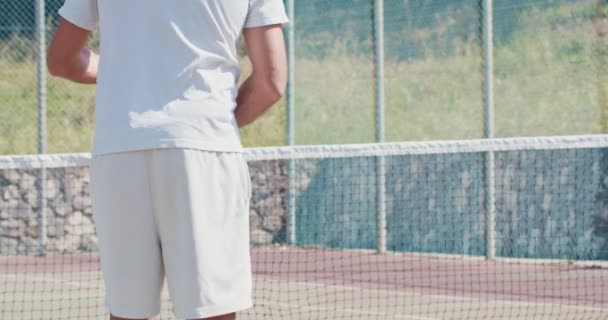 Slow motion of a tennis player hitting the ball during a tennis game