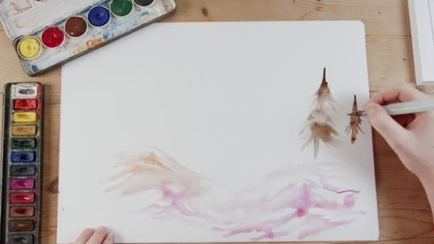 Timelapse of artist painting landscape with watercolors
