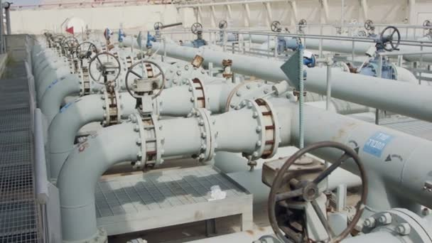 Oil and gas pipes and valves at a large oil refinery
