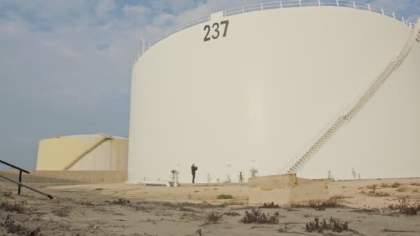Large crude oil storage tanks in a huge refinery