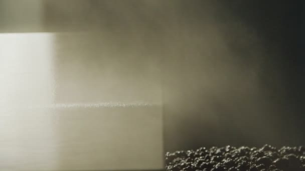 Slow motion of a worker painting kitchen wood doors using spray paint