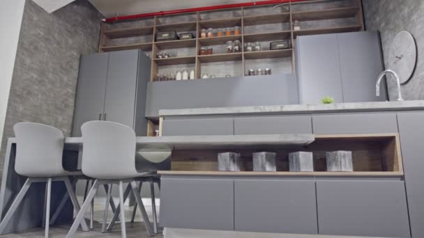 Tracking shot of a luxury kitchen with gray modern design