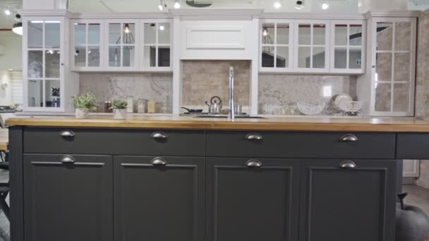 Tracking shot of a luxury kitchen with gray and white classic design
