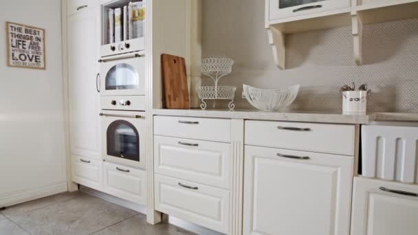 Tracking shot of a luxury kitchen with white classic design
