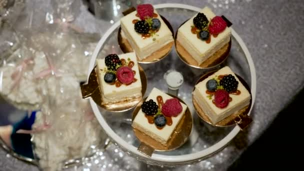 four small cakes with berries