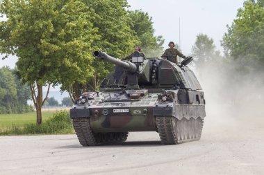 FELDKIRCHEN / GERMANY - JUNE 9, 2018: German Panzerhaubitze 2000, artillery tank drives on a road on Day of the Bundeswehr in Feldkirchen / Germany.
