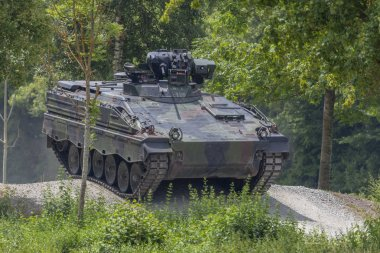 German infantry fighting vehicle drives on a road