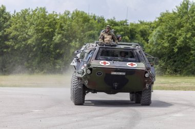 FELDKIRCHEN / GERMANY - JUNE 9, 2018: German armoured personnel carrier Fuchs, medical version drives on a road at Day of the Bundeswehr in Feldkirchen / Germany. stock vector