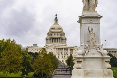 Washington DC, USA - October 12, 2017: View of the Peace Monument in front of the historical United States Capitol building in the city of Washington DC, USA
