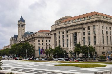 Washington DC, USA - October 12, 2017: Street view of the Old Post Office Pavilion building and clocktower and International Trade Centre building in the city of Washington DC, USA