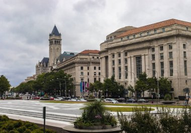 Washington DC, USA - October 12, 2017: Street view of the Old Post Office Pavilion building and clocktower and International Trade Centre building in the city of Washington DC, USA.