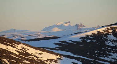 View from Mount Nuolja in Northern Sweden in midnight sun