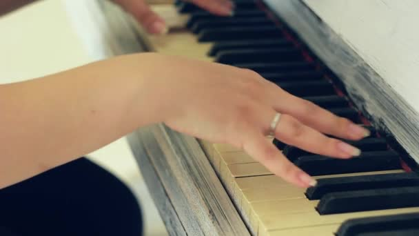 The hands of a man playing the piano