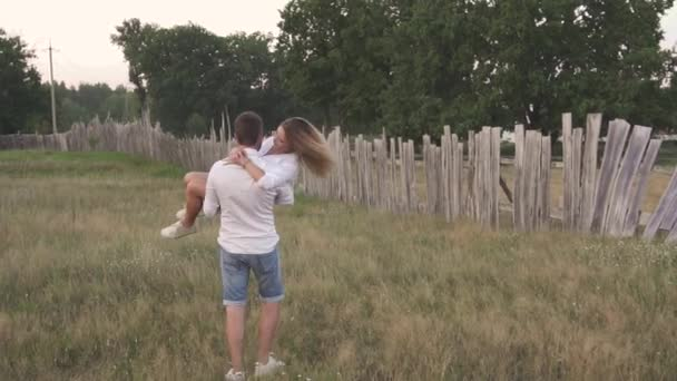 young couple in love outside the city in nature at sunset