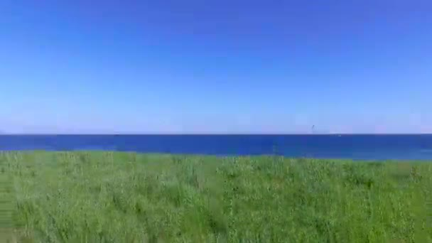 Scenic nature landscape sea, grass, sky and endless horizon line background