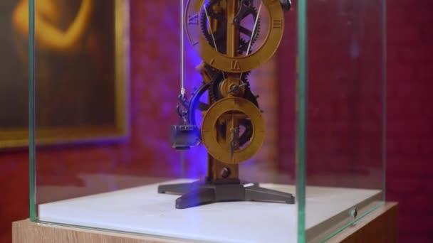 Watch by the project Leonardo Da Vinci clockwork invention of the Renaissance epoch in museum showpiece in a glass cube