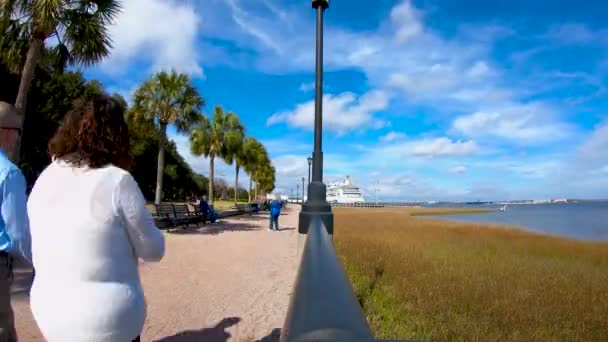 Charleston, South Carolina - FEB 16, 2019: Timelapse with people strolling along the embankment