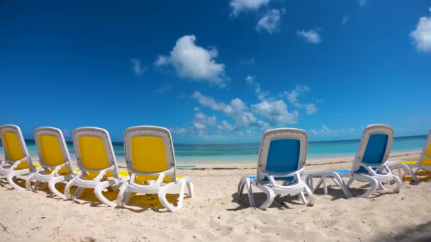 Timelapse of perfect day on the ocean coast Coco Cay landscape with bright sunbeds