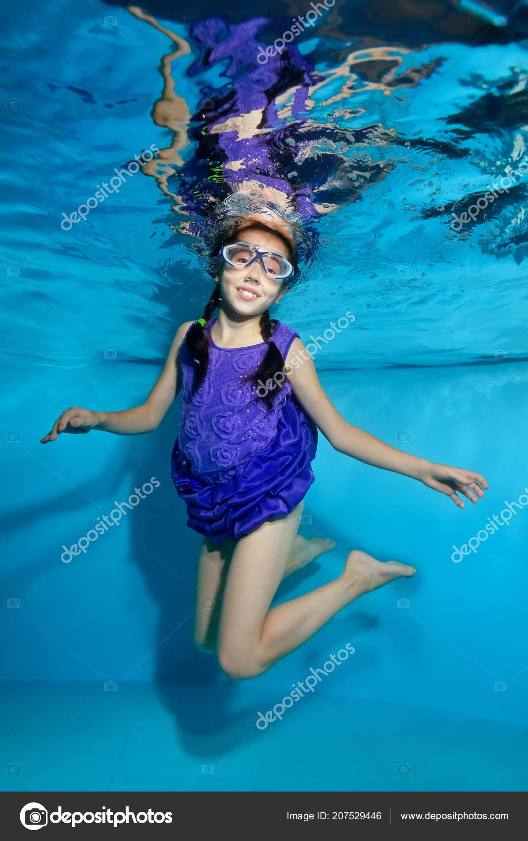 Happy Little Girl Pigtails Swims Poses Underwater Pool Swimming Glasses  Stock -9621