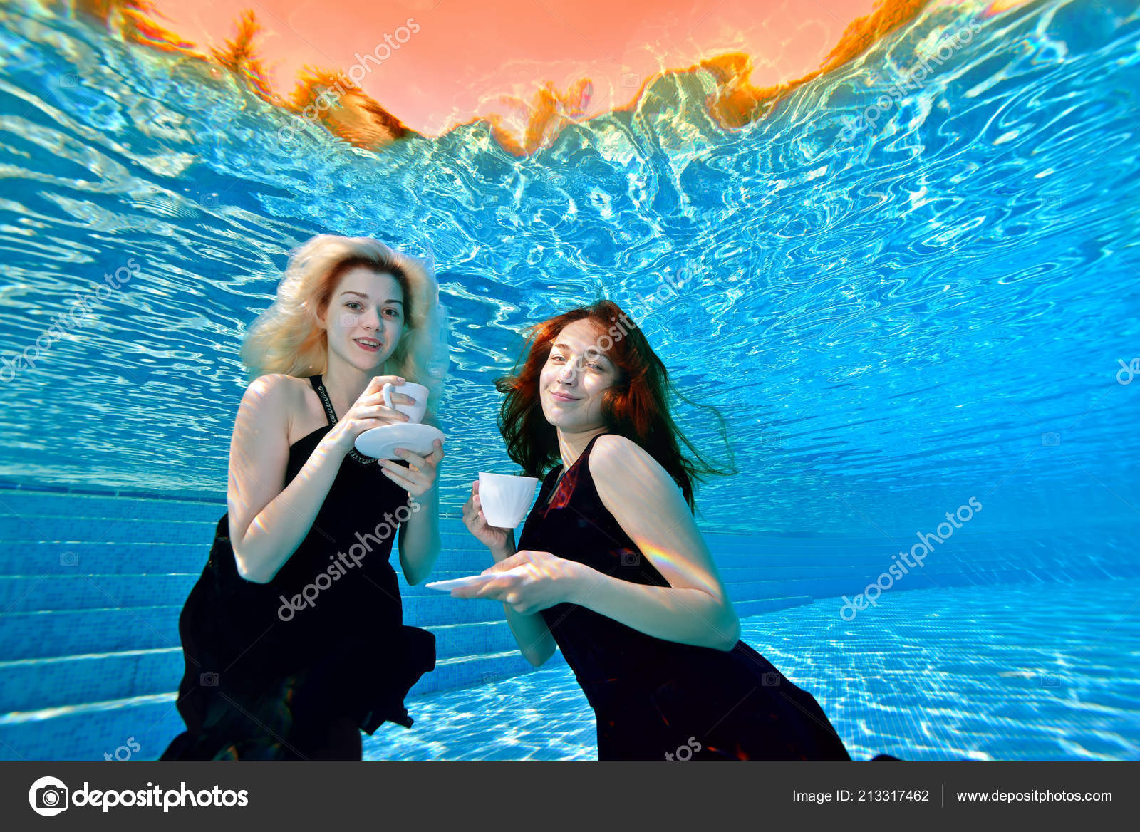 2173e29fd Two Charming Young Girls Swimming Posing Underwater Pool White Cups ...