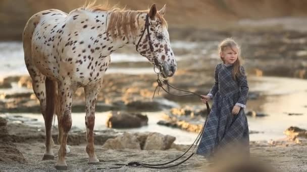 little Girl in dress walking with a horse