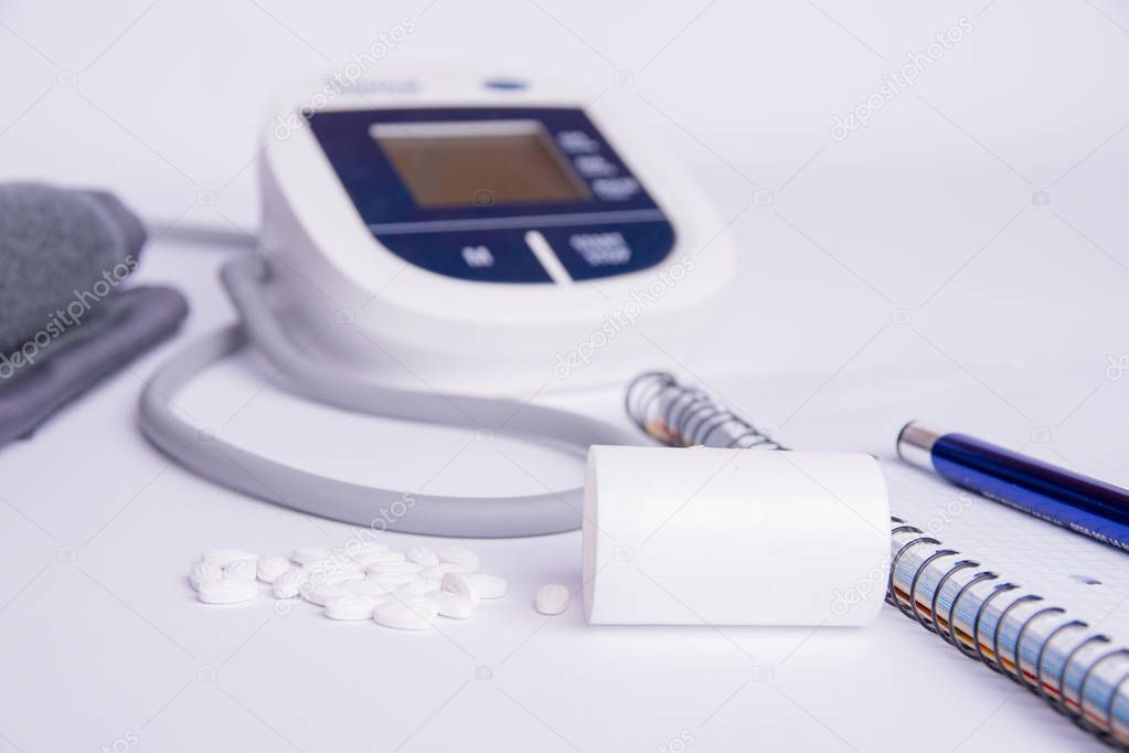 instruments for measuring blood pressure on a white background.