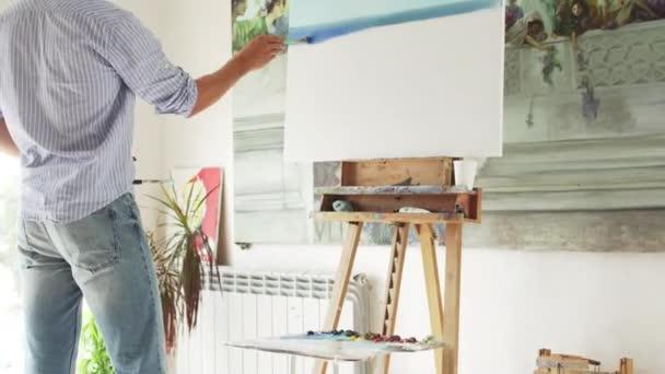 male painter paints painting