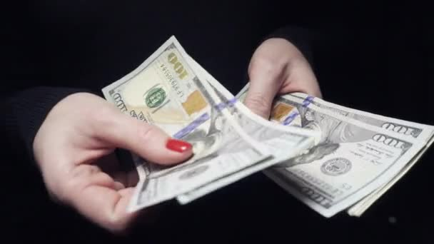 close up of female hands counting american dollars
