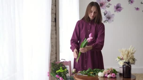 Female florists hands pruned with tulle stalks