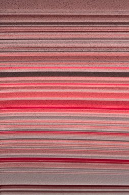 Blurry image of abstract texture background, red colors. Palette of red  shades, striped view.