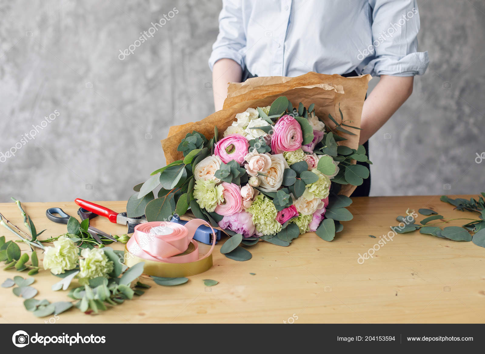 Woman Florist Creating Beautiful Bouquet In Flower Shop Working In