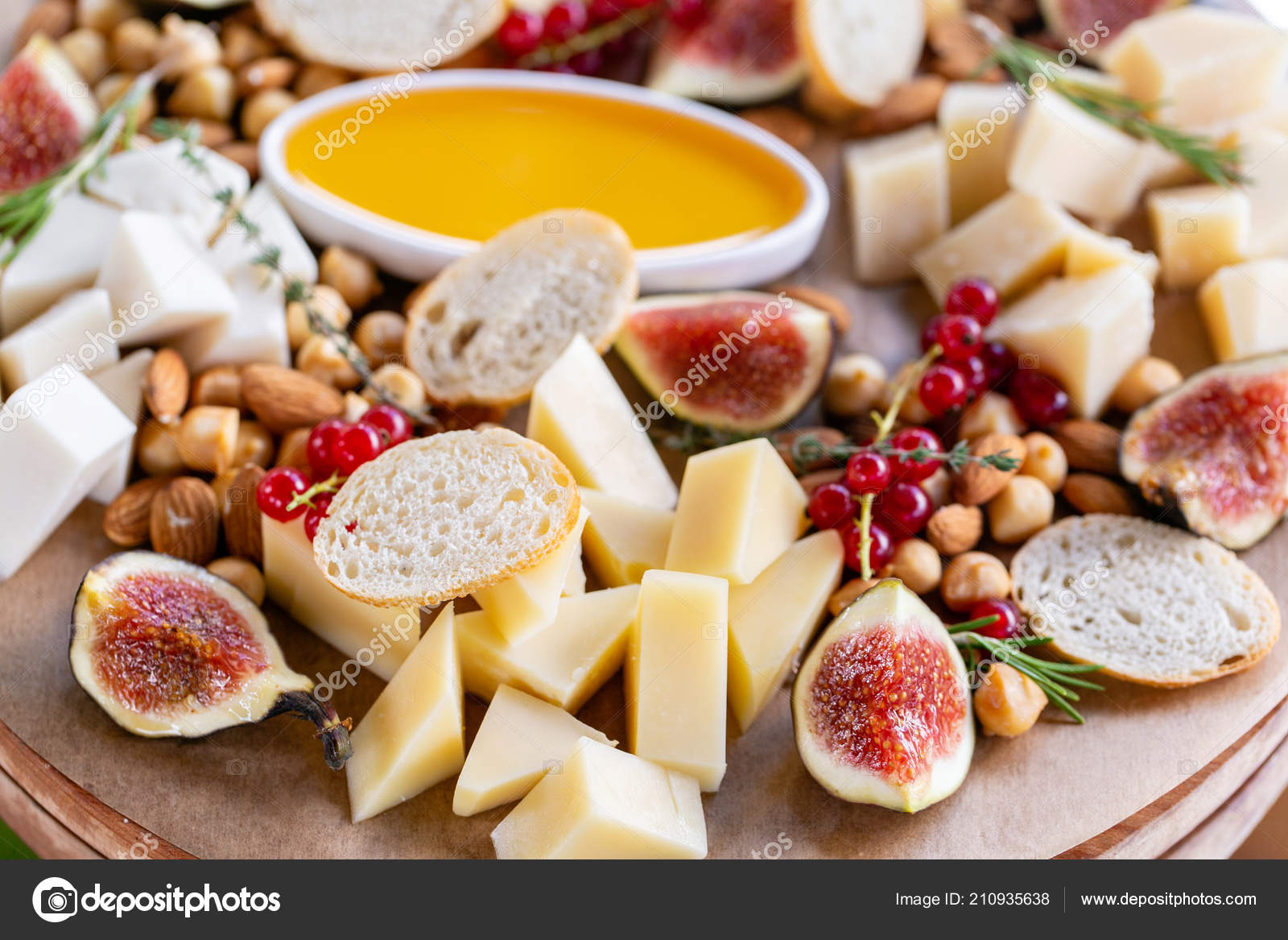 Light Italian Snacks A Buffet Table At A Dinner Party Cheese Plate Delicious Cheese Mix On Wooden Table Tasting Dish On A Wooden Plate Food For Wine Stock Photo C Malkovkosta 210935638