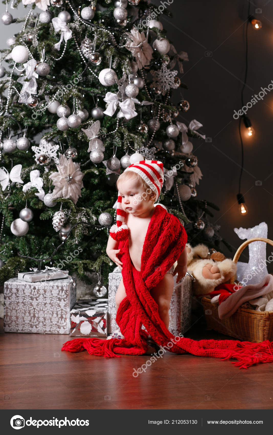 Cute baby boy and christmas gifts. Little child having fun near ...