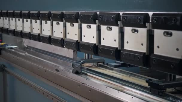 Tool and bending equipment for sheet metal. manufacture workshop. Workers adjusts the machine in the warehouse. the production of ventilation and gutters.