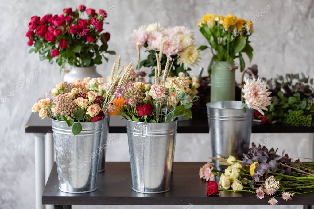 Florist workplace. close-up of flowerpots with flowers. A teacher of floristry in master classes or courses