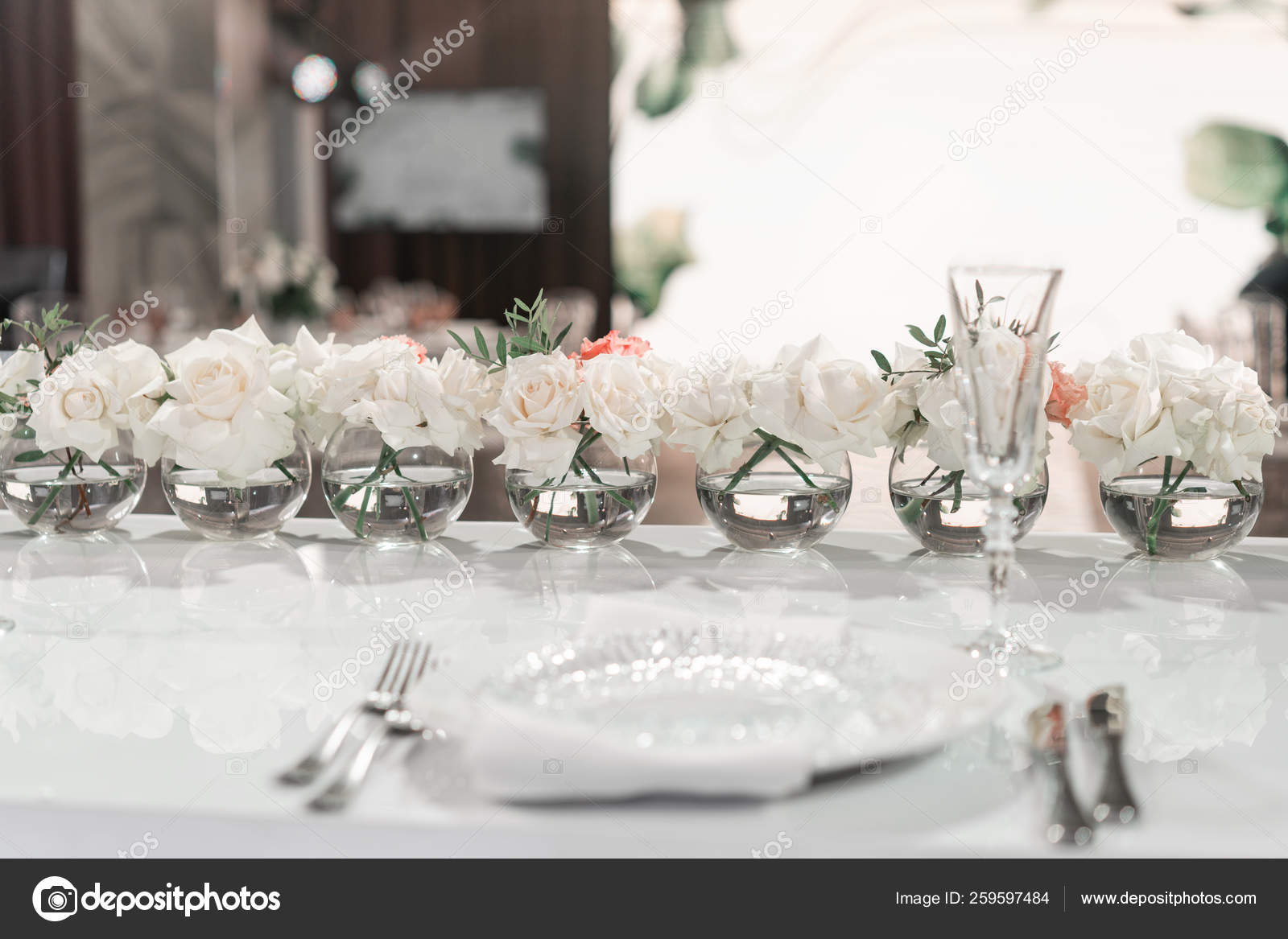 Small Flower Arrangements In Ball Glass Vases The Table Of The Newlyweds Interior Of Restaurant For Wedding Dinner Ready For Guests Catering Concept Stock Photo C Malkovkosta 259597484