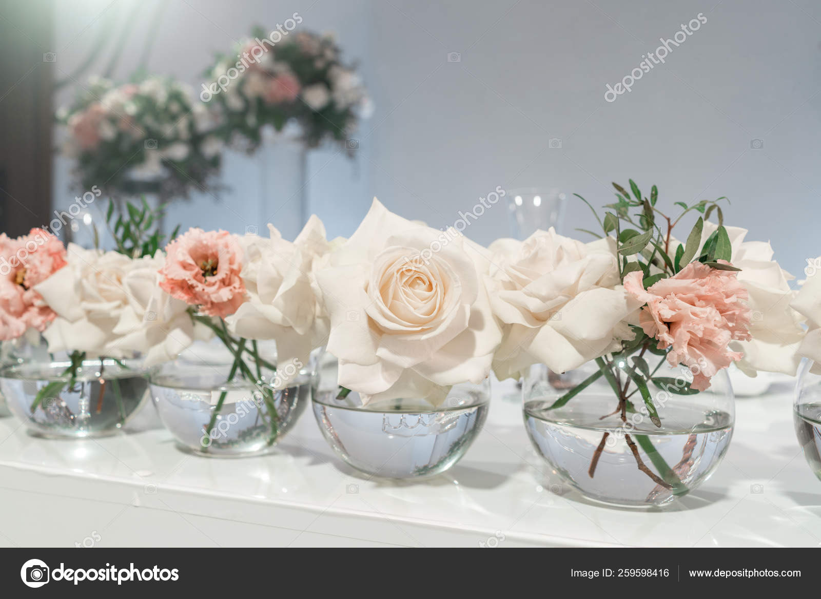 Small Flower Arrangements In Ball Glass Vases The Table Of The Newlyweds Interior Of Restaurant For Wedding Dinner Ready For Guests Catering Concept Stock Photo C Malkovkosta 259598416